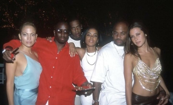 Aaliyah photoed chilling with Diddy, J.Lo, and Jay Z