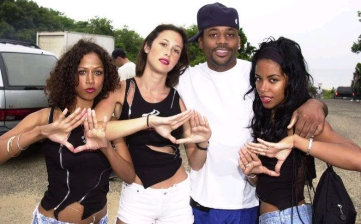 Aaliyah throws up the Roc sign with Dame Dash and Stacy Dash.