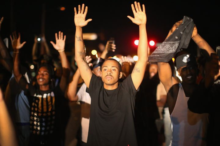 Demonstrators protest the shooting of 18-year-old Michael Brown.