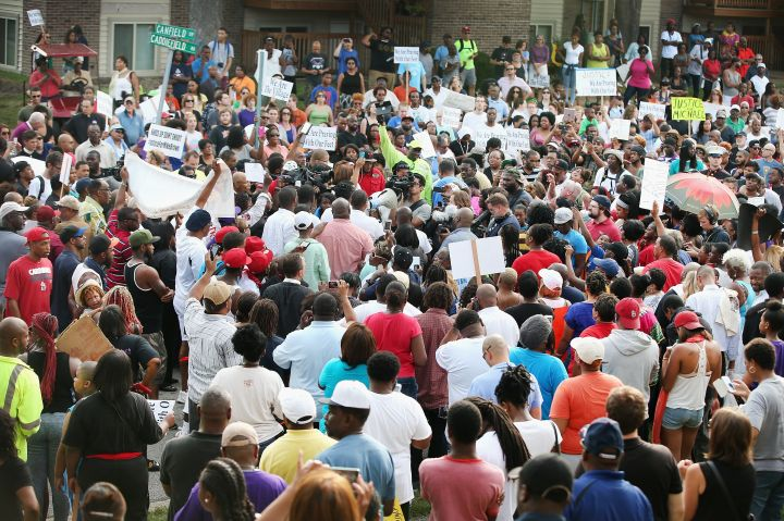 Crowds gather to protest the shooting of unarmed 18-year-old Michael Brown.