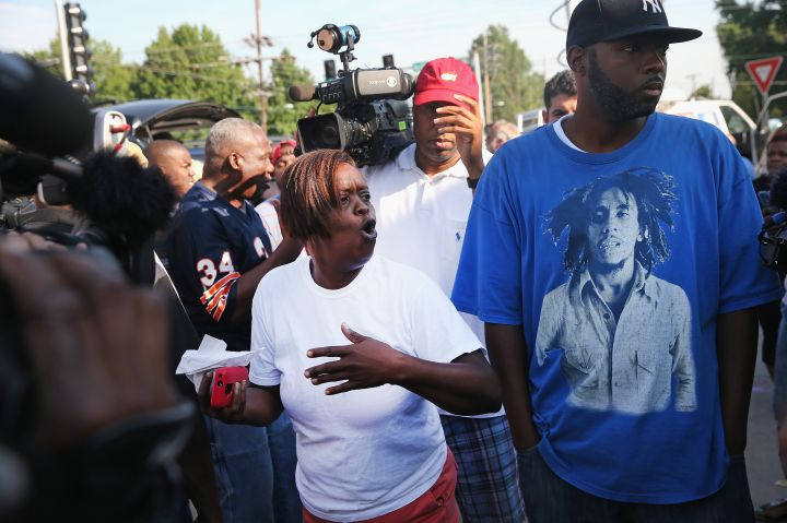 People react to the naming of the officer who shot and killed unarmed Michael Brown.