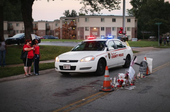 Memorial for Michael Brown stands in the middle of the street where he was gunned down.