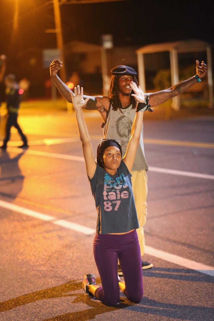 Demonstrators in the streets of Ferguson protest after the killing of unarmed teen Michael Brown.