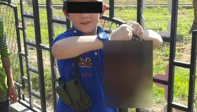 Australian Boy Poses With A Severed Head