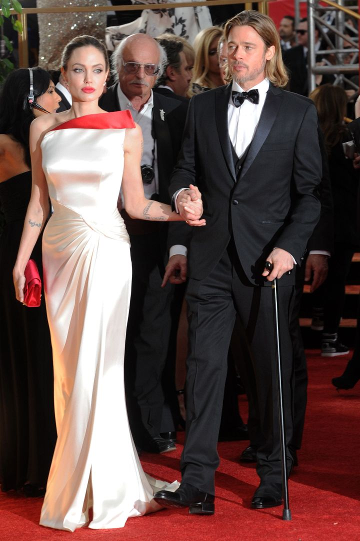 Angelina helps an injured Brad get through the red carpet.