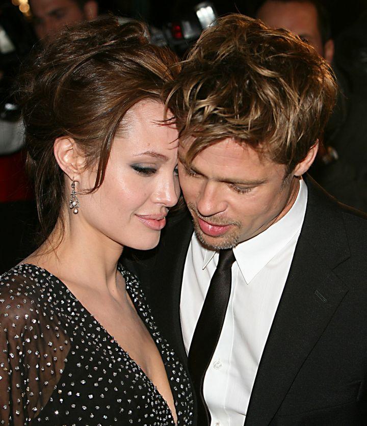 Brad Pitt and Angelina snuggle up close wherever they go.