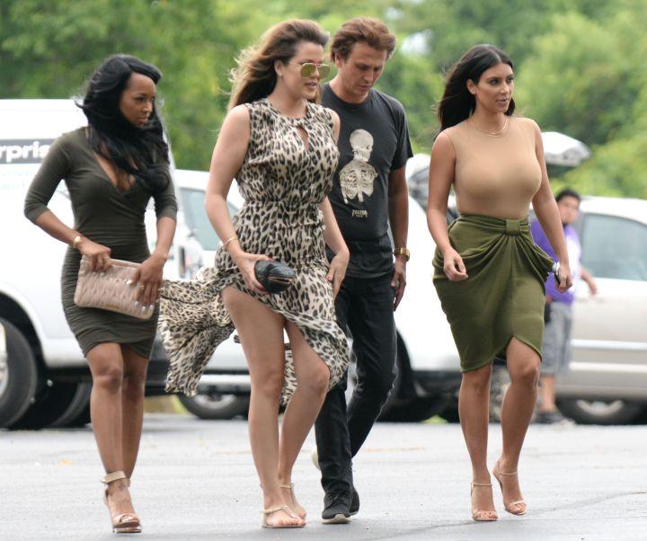 Kim Kardashian and sister Khloe Kardashian with a wardrobe malfunction filming KUWK in the Hamptons.