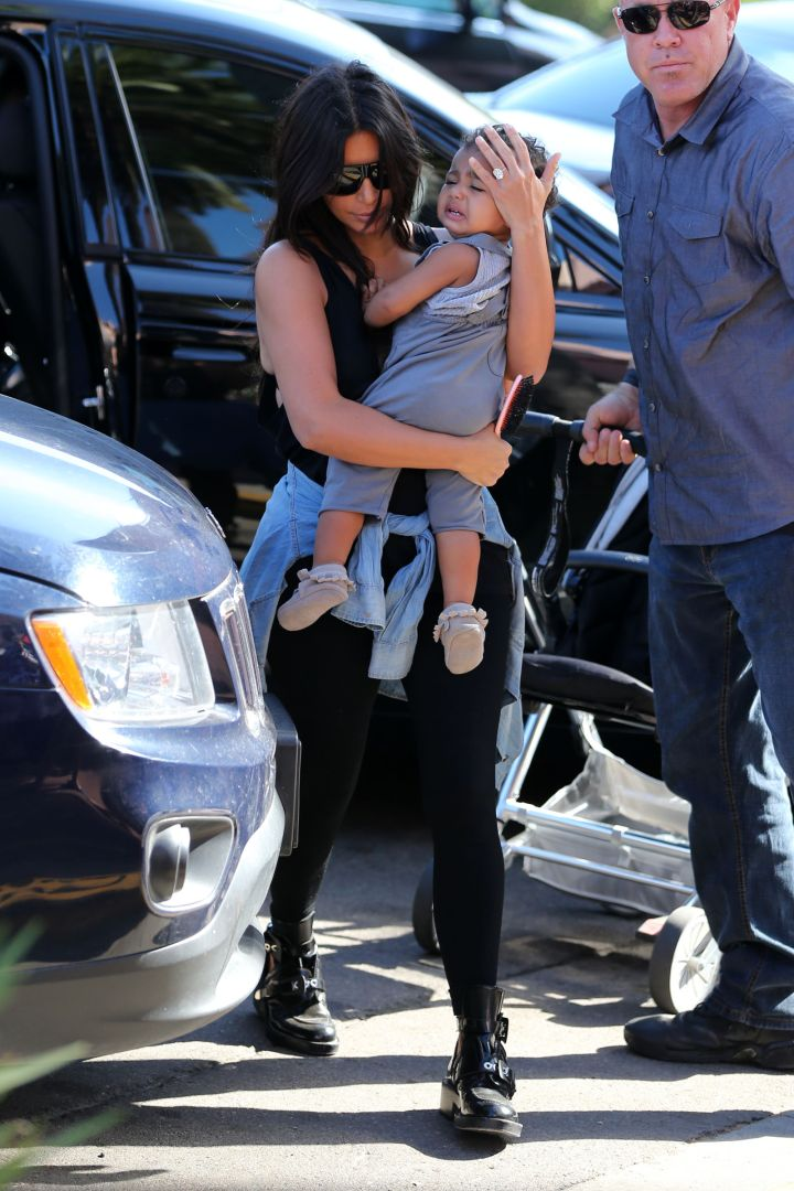 North cries in her mommy's arms.