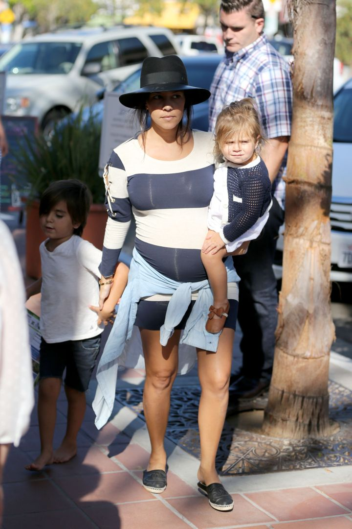 Penelope Disick gives the paps a mean mug while Kourt shows off her bump