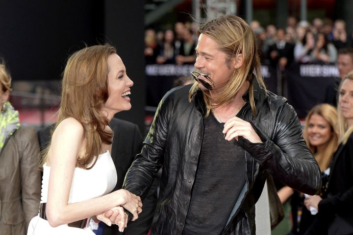 Brad Pitt & Angelina share a moment of laughter.