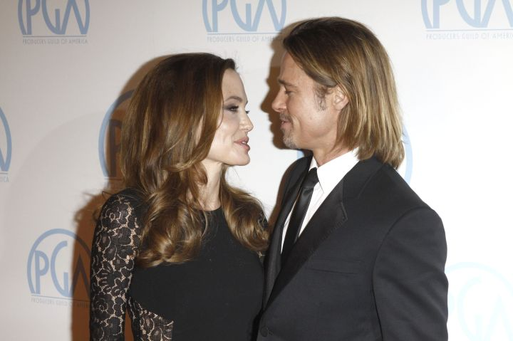 Brad Pitt and Angelina Jolie stare deeply into each other's eyes.