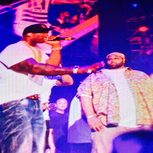 Fiddy on stage with his 'guard.