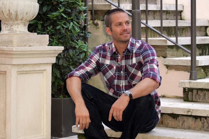 """Walker poses for promo photos while shooting """"Fast & Furious 5″ in Rome in 2011."""