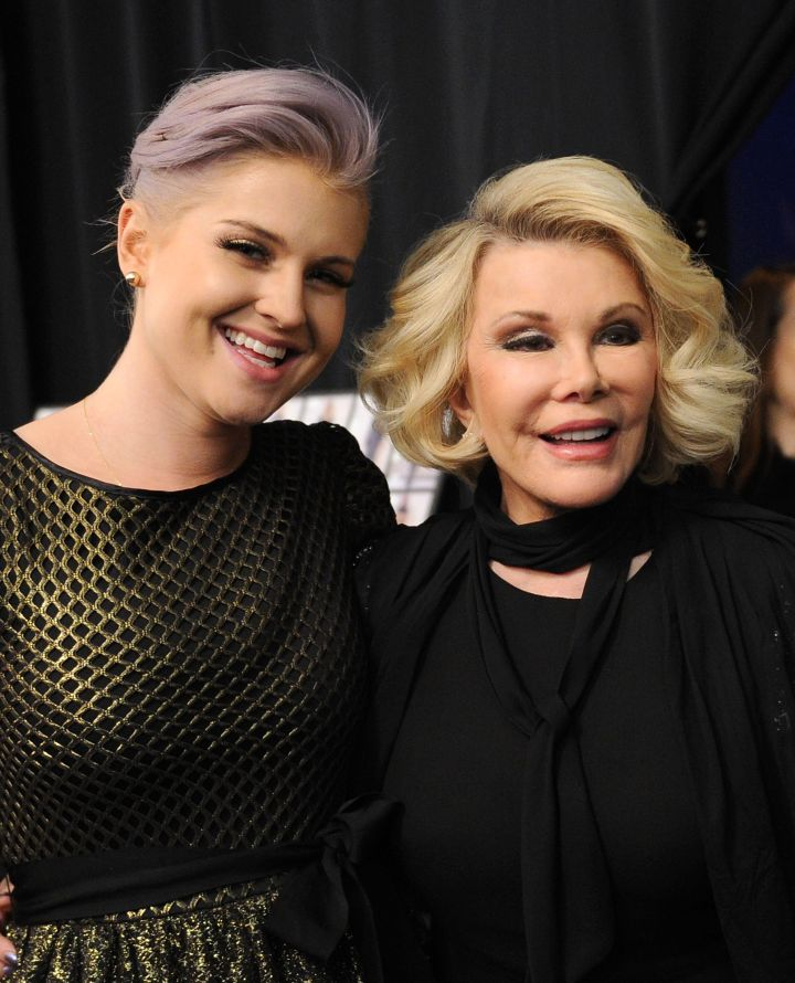 """Joan and her """"Fashion Police"""" co-star Kelly Osbourne pose together backstage at Badgley Mischka's Fall 2012 showing."""