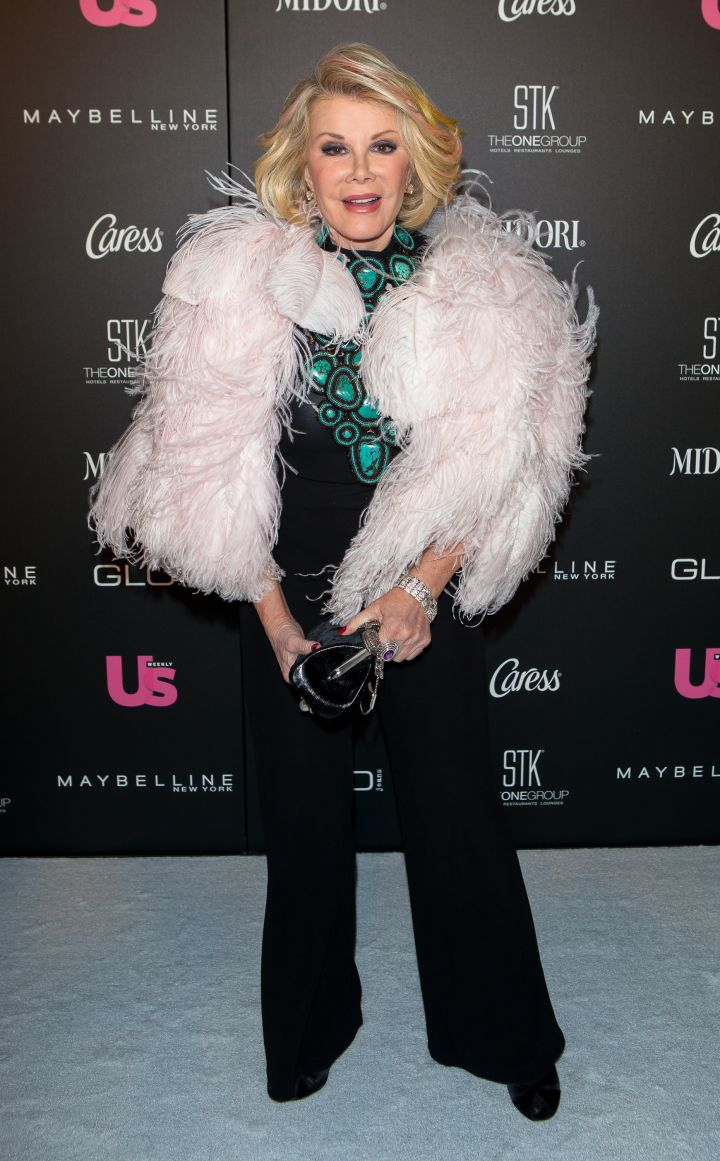 Joan sports an over-the-top feather jacket at Us Weekly's 25 Most Stylish New Yorkers Event.