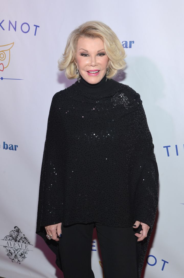 Joan steps out in all black to check out the Tie The Knot Spring Collection.