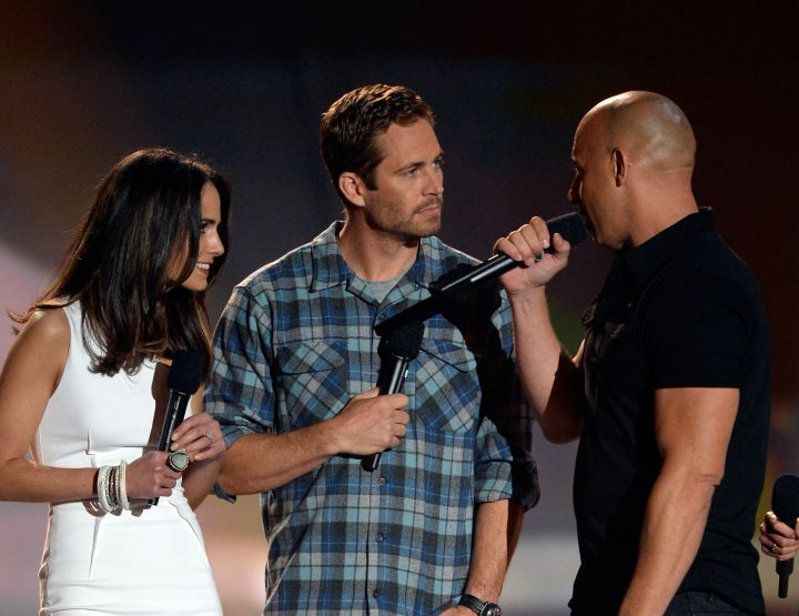 """Paul and the rest of the """"Fast & Furious"""" crew accept an award for their amazing work at the 2013 MTV Movie Awards."""