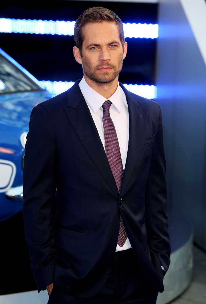 """Walker rocks blue and purple for the """"Fast & Furious 6″ world premiere in 2013."""