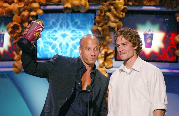 Paul Walker and co-star Vin Diesel accept their golden popcorn at the MTV Movie Awards in 2002.
