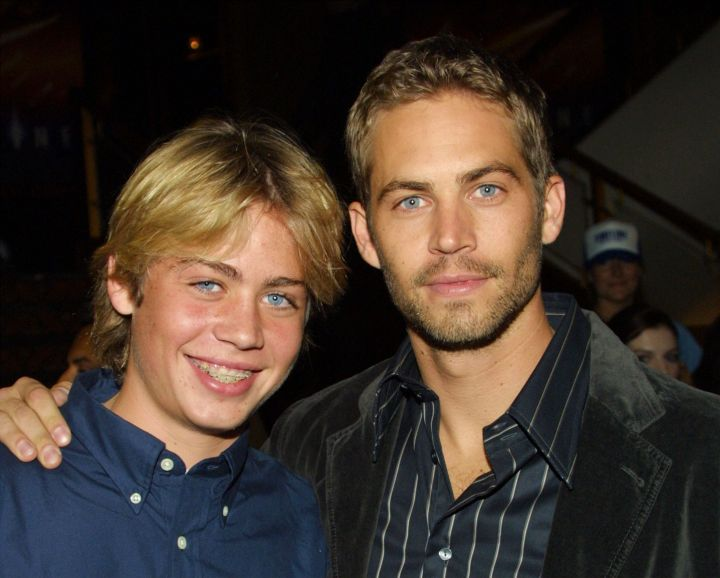 """Walker poses with his younger brother Cody at the Los Angeles premiere of """"Timeline."""""""
