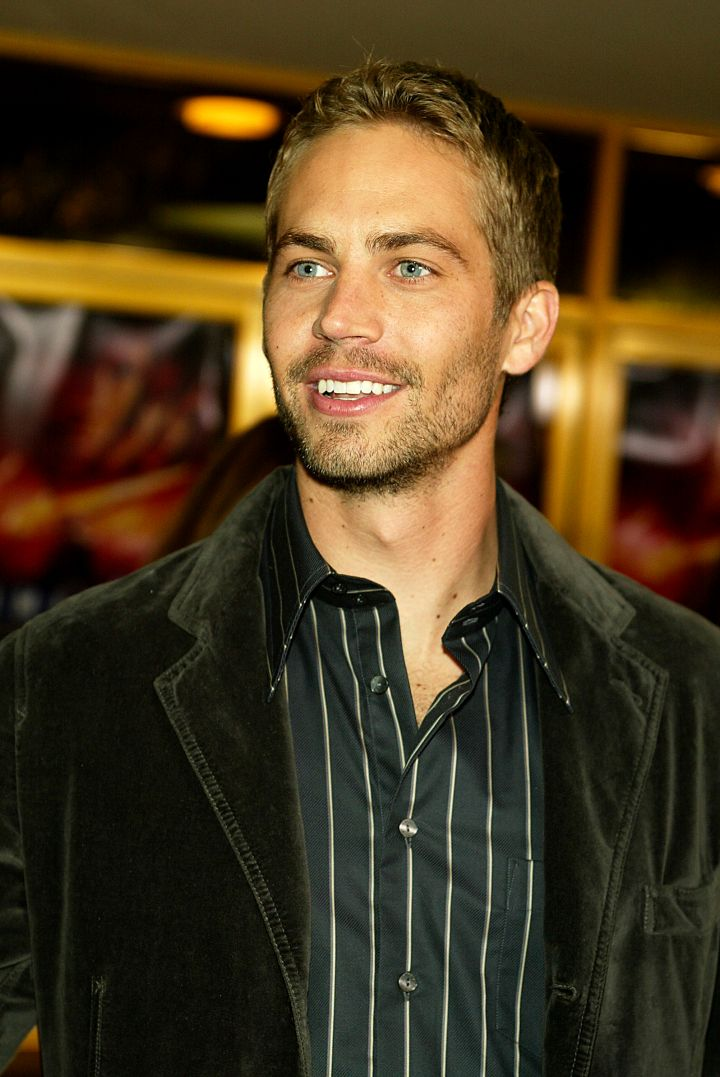 """Paul steps out in a crushed velvet suit jacket at the premiere of """"Timeline"""" in 2003."""