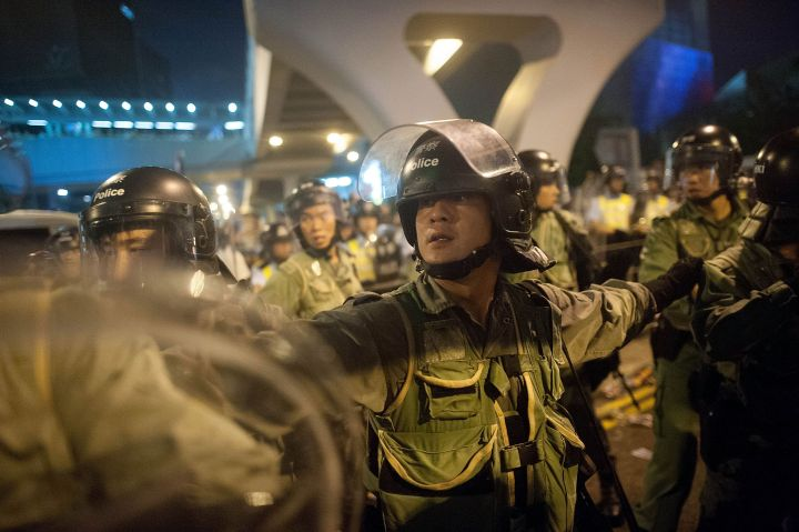 Police and demonstrators clash in the street during Hong Kong's Umbrella Revolution, spurred by Chinese government's plans to vet candidates in Hong Kong's 2017 elections.