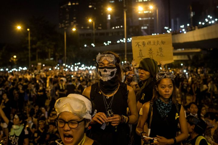 Thousands of pro democracy protestors unhappy with Chinese government's plans to vet candidates in Hong Kong's 2017 elections gather in the streets to demonstrate.