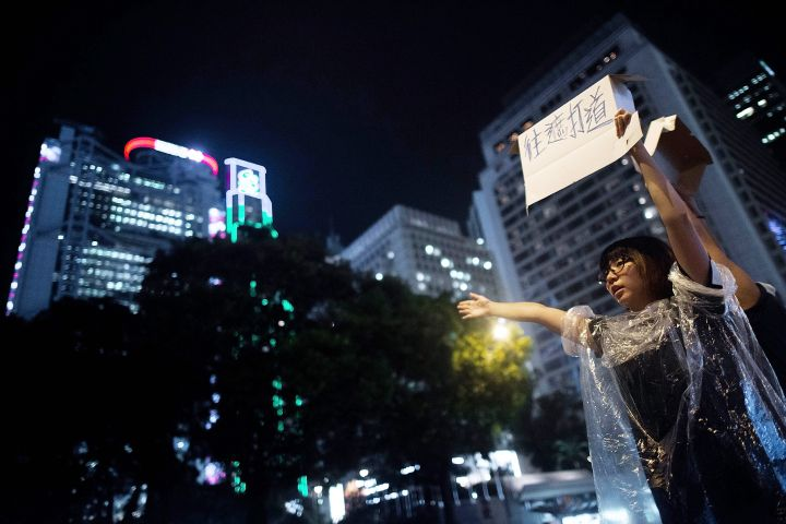 A man holds up a sign during Hong Kong's Umbrella Revolution.