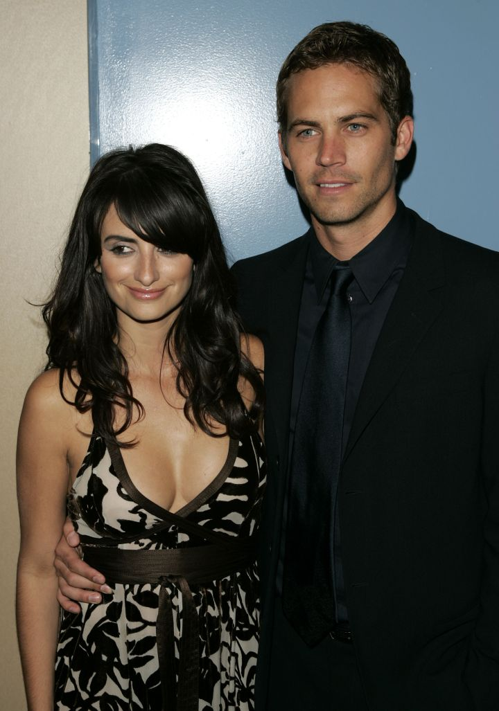 """Penelope Cruz and Paul pose for cameras at the premiere of the film """"Noel"""" in 2003."""