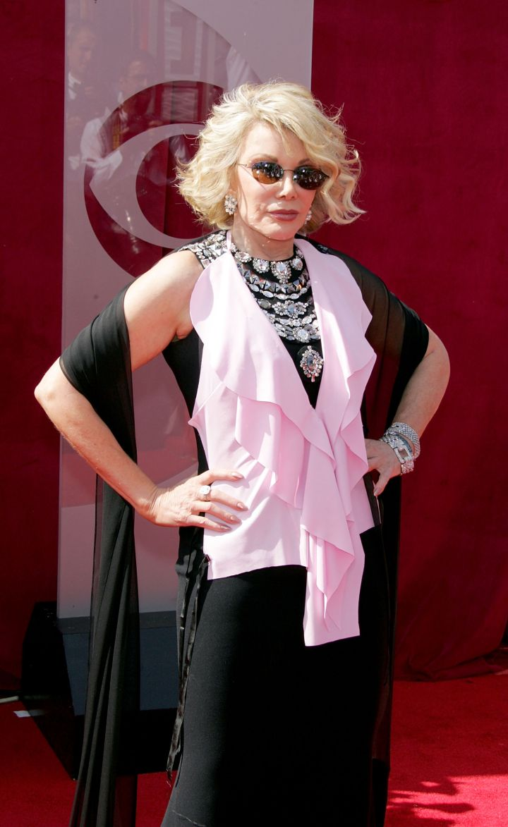 Joan sporting a jewel encrusted gown with a pink shawl at the 2005 Emmy Awards.