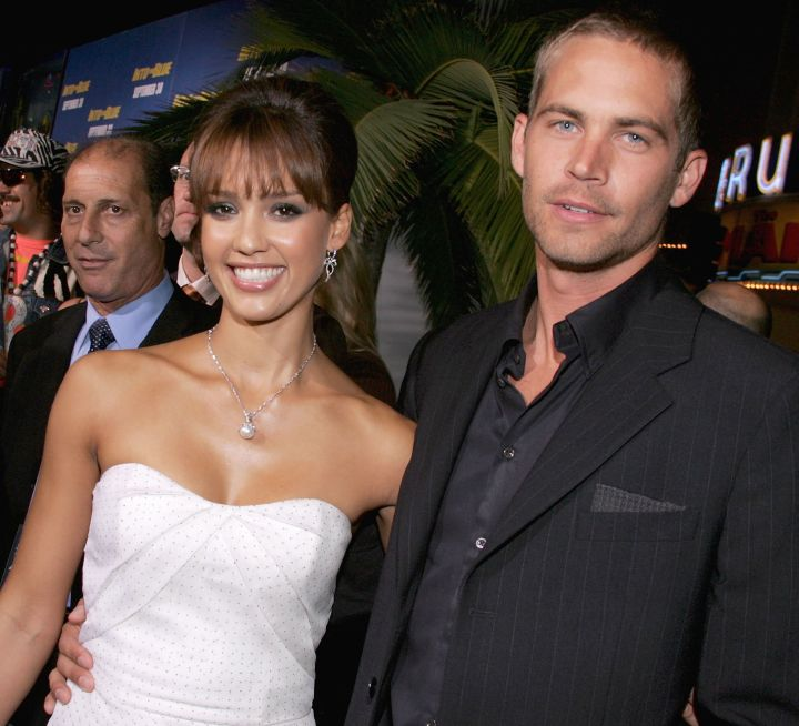 """Paul and his """"Into The Blue"""" castmate Jessica Alba kick it at the film's premiere in 2005."""