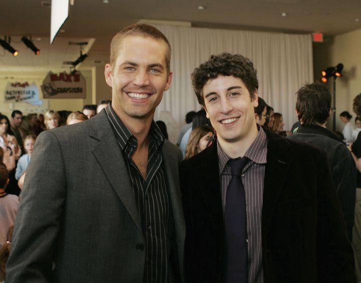 """Walker poses with Jason Biggs at the 2006 premiere of """"Eight Below."""""""