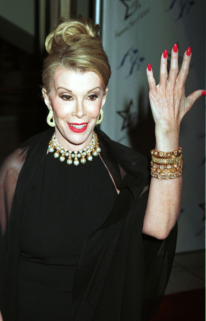 Rivers flashes her freshly manicured nails at the 28th Annual FiFi awards in 2000.