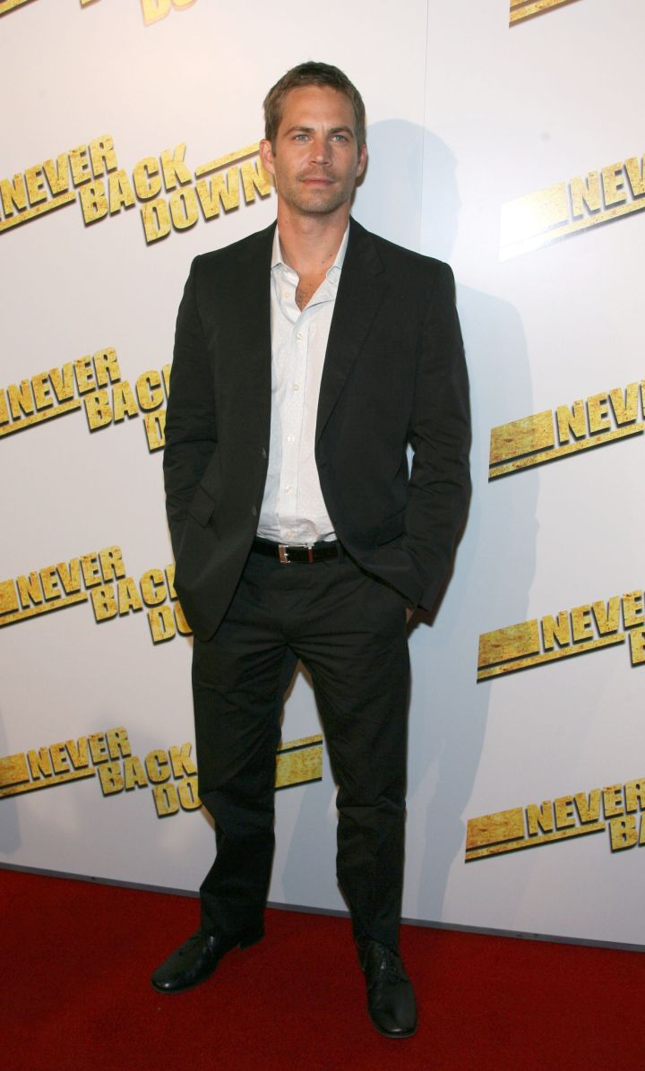 """Walker sports a fitted black suit for the 2008 premiere of """"Never Back Down."""""""