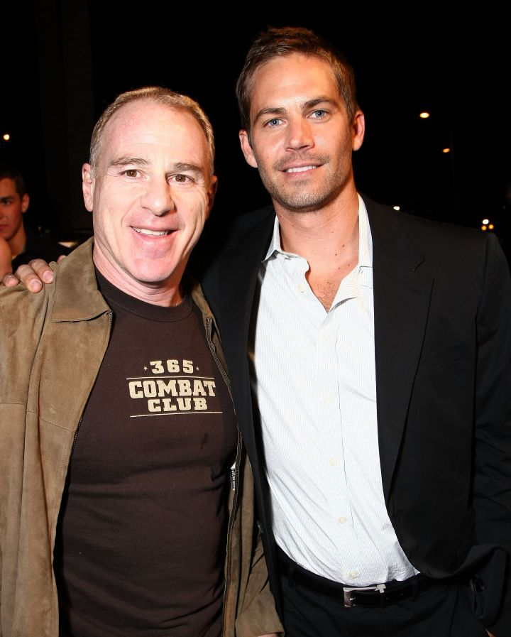 """Paul poses alongside David Zelon, the producer behind the """"Fast & Furious"""" franchise, at the premiere of """"Never Back Down"""" in 2008."""