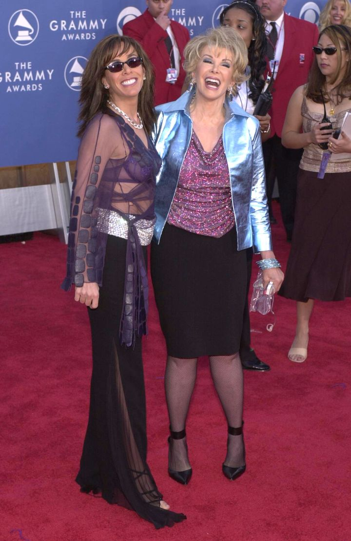 Check out Joan and Melissa's wild outfits from the 43rd Annual Grammy Awards.