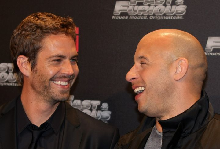 """Paul and Vin, who were not only co-stars, but close friends, share a laugh before heading in to the """"Fast & Furious"""" premiere in 2009."""