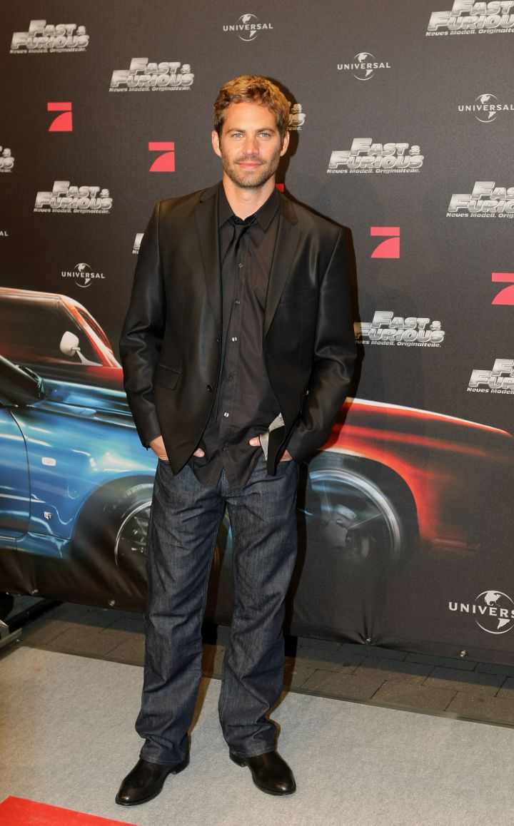 """Paul sports a shiny sport coat, black button down, denim and his million dollar smile for the European premiere of """"Fast & Furious."""""""