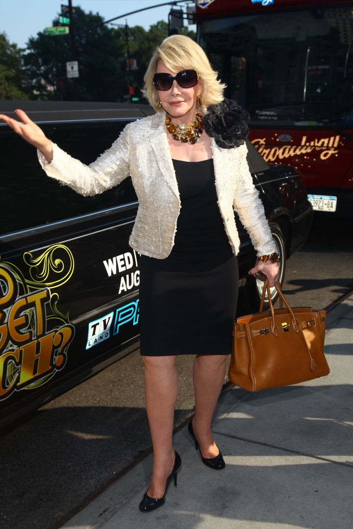 """Joan's always flashy, so we're not at all surprised to see photos of her promoting the show """"How'd You Get So Rich?"""""""
