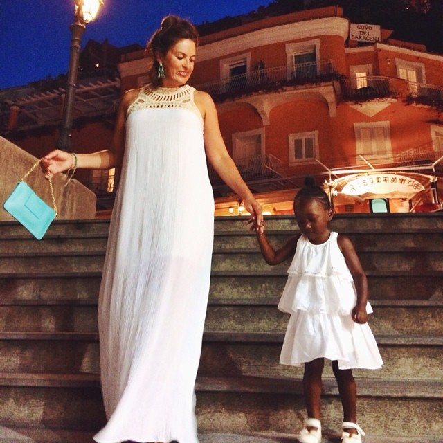 Mommy and daughter in all white.