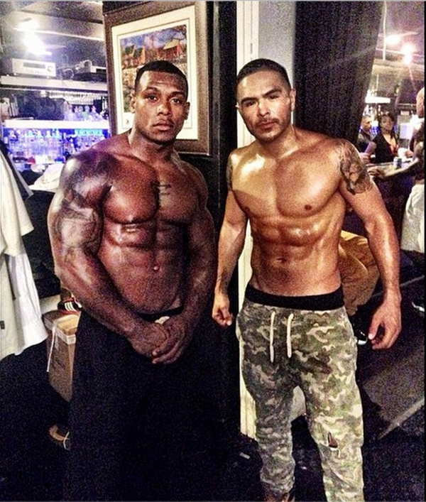 Some of the guys on set show off their abs.