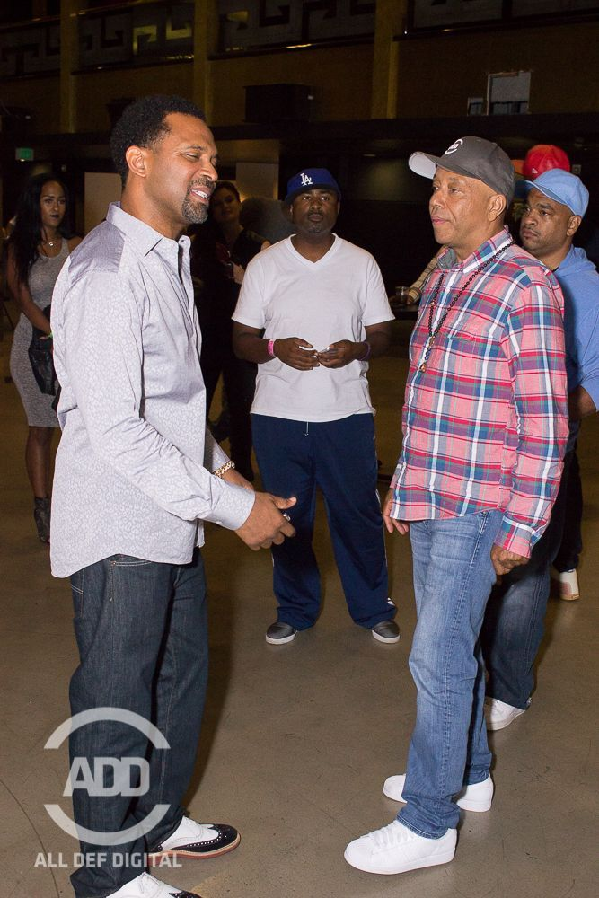 Russell Simmons and Mike Epps chop it up at the show.
