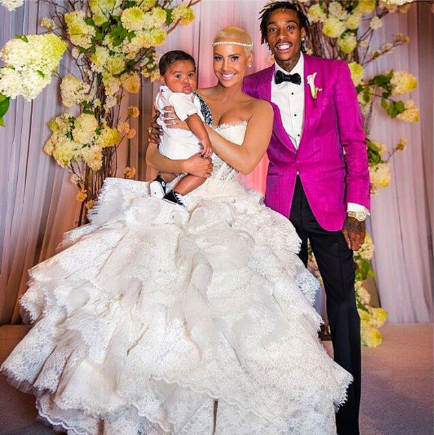 A year after he popped the question, Wiz and Amber tied the knot with Baby Bash by their side.