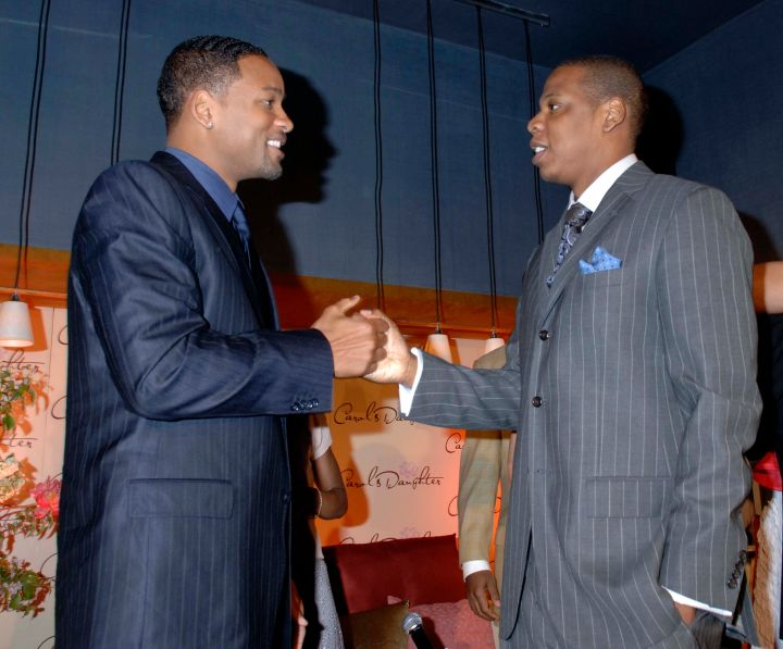 Suited up! Will talks business with Jay Z.