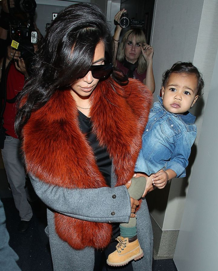 North sat pretty on her mom's hip back in September when she wore this adorable little denim top.