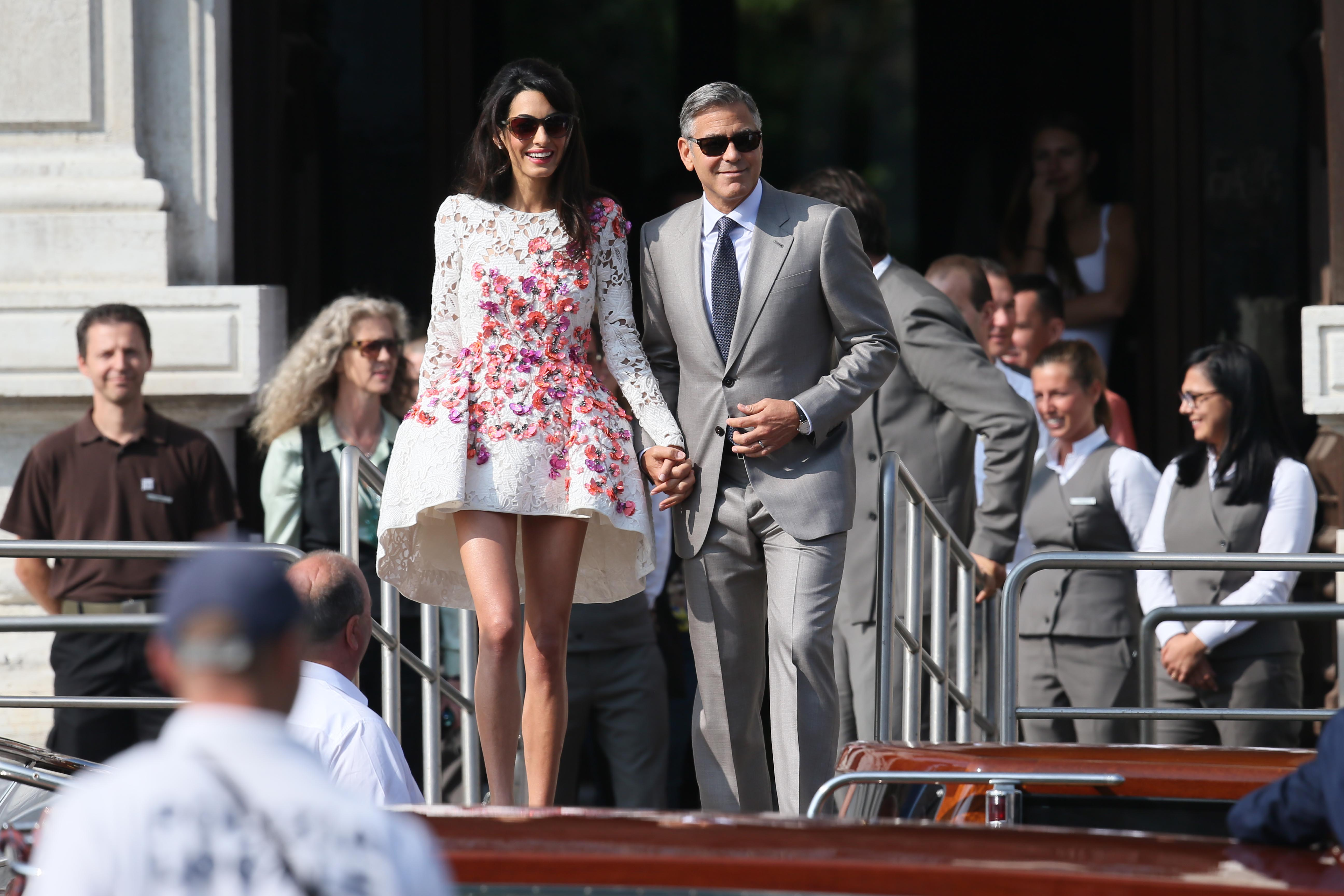 newly married George Clooney and his wifevAmal Alamuddin leave the Aman Canal Grande in venice