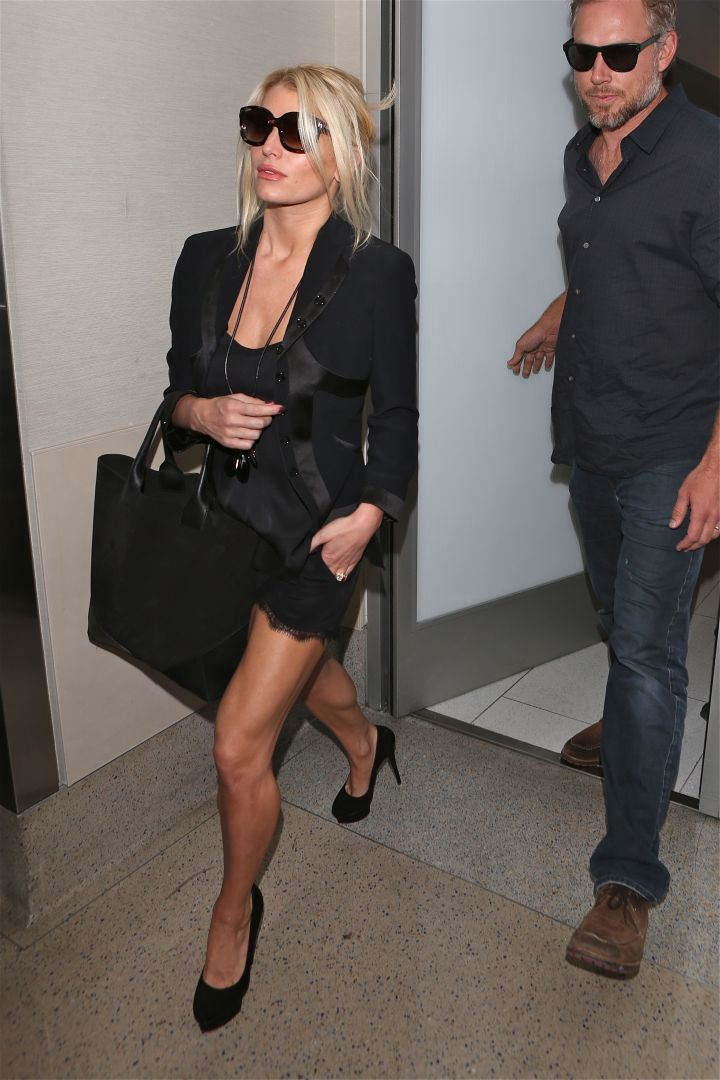 Hot mama Jessica Simpson and her hubby Eric Johnson depart from LAX in style.