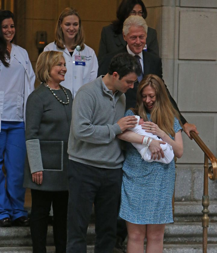 Chelsea Clinton, her husband Marc Mezvinsky, and her parents President Bill Clinton and Hillary Clinton leave Lenox Hill Hospital with newborn Charlotte in New York City.