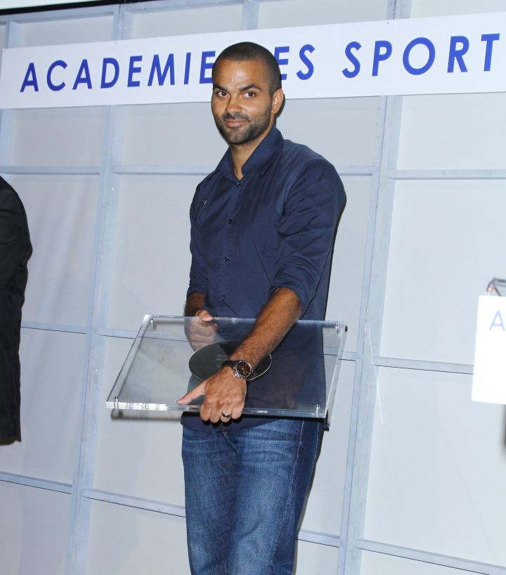 Tony Parker shows off his 2013 Sport Academy Award in Paris.