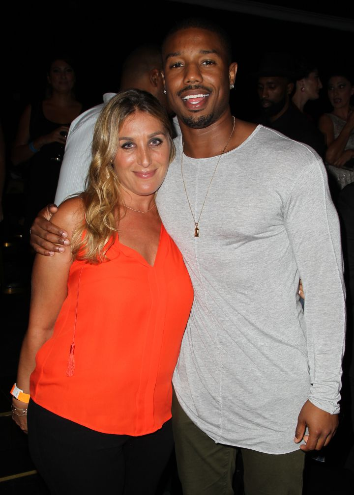 Michael B. Jordan and Nicole Fogel take advantage of a photo op during a charity event.